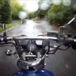 A Motorcycle rider riding his bike in rain