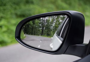 A picture of Car's side mirror view of road
